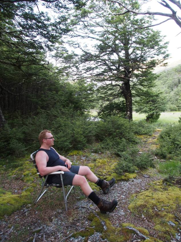 Dylan relaxing in a lawn chair at Caroline Creek Bivvy